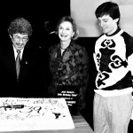 A specially decorated cake, provided for the occasion by Jarosch Bakery of Elk Grove Village, is admired by Chuck Schaden, Joan Benny and Bobby Blumofe. The cake was later served to the audience, the cast and special guests.
